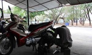 Thai mechanic fixing a bike