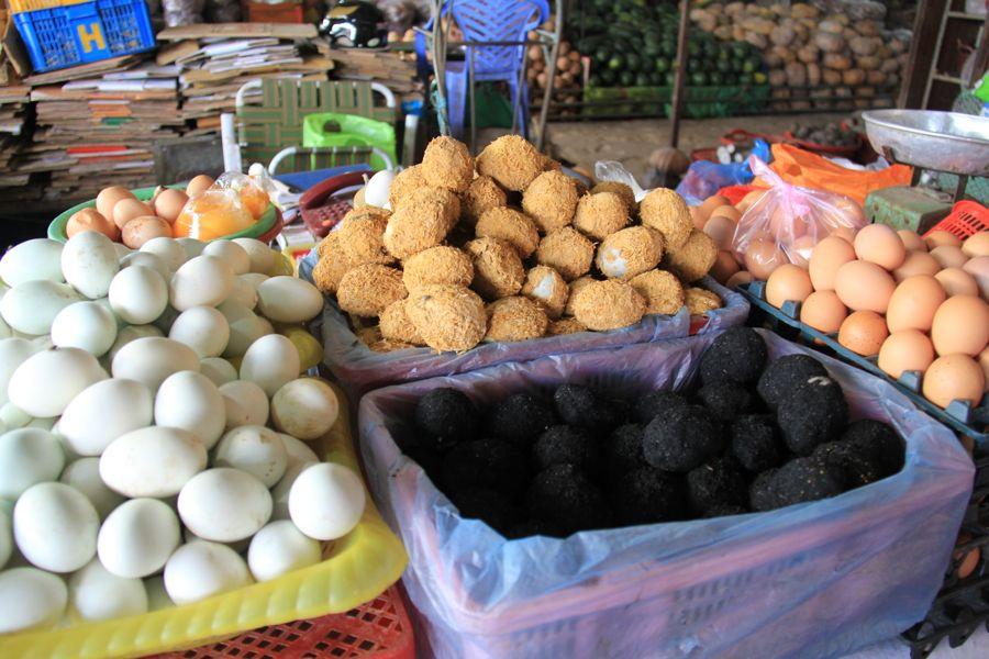century eggs in ben tre market, vietnam