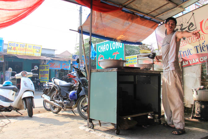 A cook in Vietnam taking orders