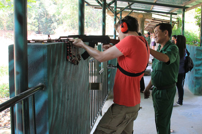 Ryan shooting an AK-47 at the Cu Chi Tunnels in Vietnam