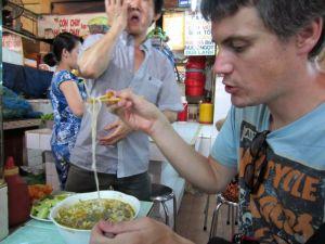 Eating soup at Ben Thanh Market, Ho Chi Minh City, Vietnam